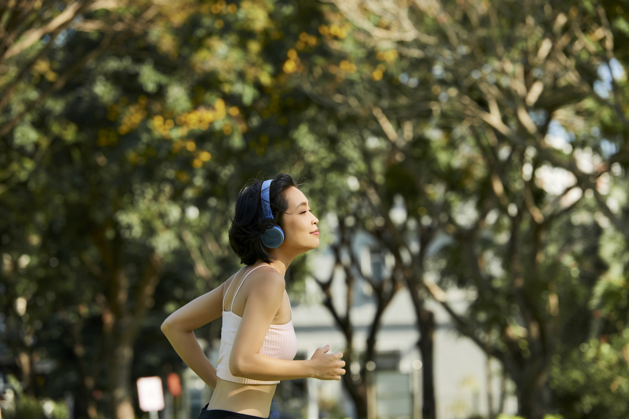 Fit woman jogging in park